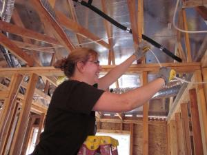 There I am, stringing wire in a Habitat for Humanity house.